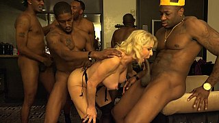 GILF enjoys an interracial gang-bang