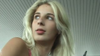 Mesmerizing Russian blondie washes car windows in sultry top