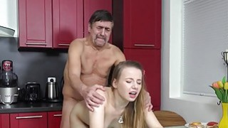 Steamy sex in the kitchen between young babe