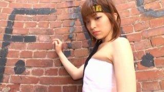 Redhead samurai from Japan Ryoko Tanaka poses near the brick wall